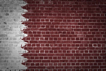 An image of the Qatar flag painted on a brick wall in an urban location Stock Photo - 12422711