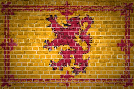 rampant: An image of the Scotland Lion Rampant flag painted on a brick wall in an urban location Stock Photo