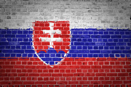 slovakia flag: An image of the Slovakia flag painted on a brick wall in an urban location