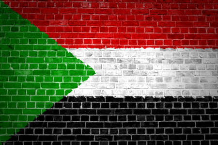 An image of the Sudan flag painted on a brick wall in an urban location Stock Photo - 12422735