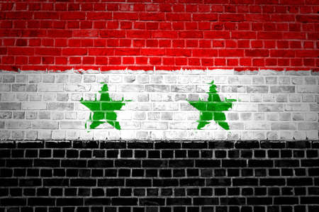 An image of the Syria flag painted on a brick wall in an urban location Stock Photo - 12422713