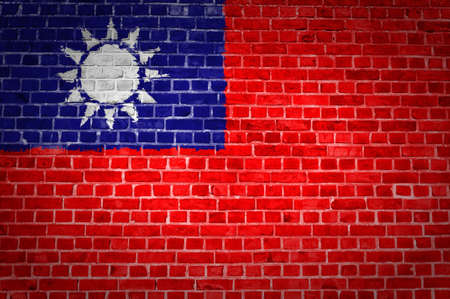 An image of the Taiwan flag painted on a brick wall in an urban location photo