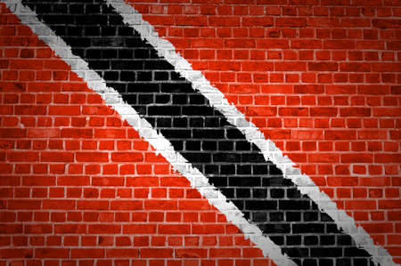 national flag trinidad and tobago: An image of the Trinidad and Tobago flag painted on a brick wall in an urban location