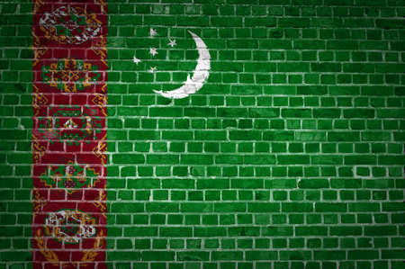 An image of the Turkmenistan flag painted on a brick wall in an urban location photo