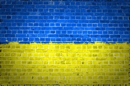 ukraine: An image of the Ukraine flag painted on a brick wall in an urban location Stock Photo