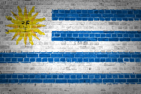 uruguay: An image of the Uruguay flag painted on a brick wall in an urban location Stock Photo