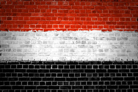 An image of the Yemen flag painted on a brick wall in an urban location Stock Photo - 12422714