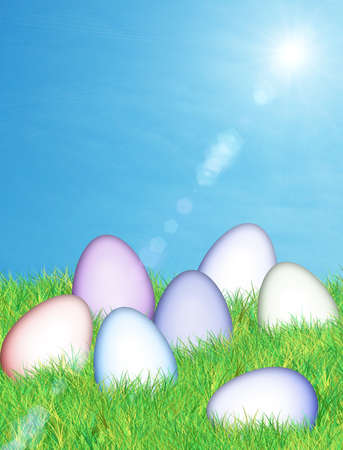 colorful easter eggs lying in lush green grass with a cool blue sky background photo