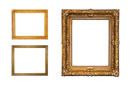 Old ornate golden frames isolated on a white background photo