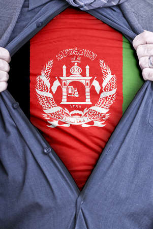 afghan flag: An Afghan businessman rips open his shirt and shows how patriotic he is by revealing his countries flag beneath printed on a t-shirt
