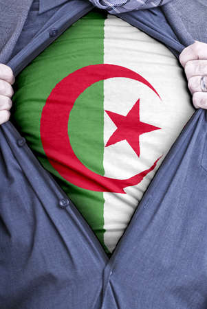 algerian flag: An Algerian businessman rips open his shirt and shows how patriotic he is by revealing his countries flag beneath printed on a t-shirt