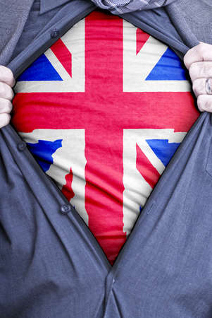 A British businessman rips open his shirt and shows how patriotic he is by revealing his countries flag beneath printed on a t-shirt Stock Photo - 12991188