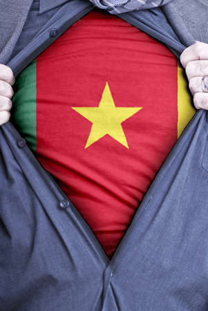 cameroonian: A Cameroonian businessman rips open his shirt and shows how patriotic he is by revealing his countries flag beneath printed on a t-shirt