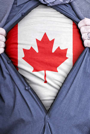 canada flag: A Canadian businessman rips open his shirt and shows how patriotic he is by revealing his countries flag beneath printed on a t-shirt Stock Photo