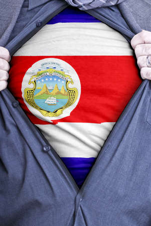 costa rican flag: A Costa Rican businessman rips open his shirt and shows how patriotic he is by revealing his countries flag beneath printed on a t-shirt Stock Photo