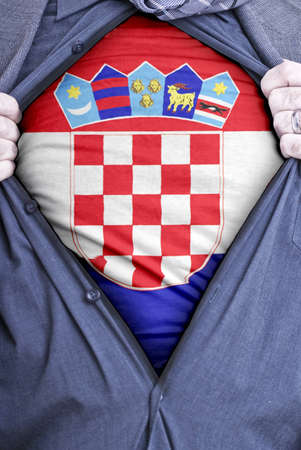A Croatian businessman rips open his shirt and shows how patriotic he is by revealing his countries flag beneath printed on a t-shirt Stock Photo - 12991155