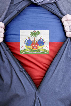 haitian: A Haitian businessman rips open his shirt and shows how patriotic he is by revealing his countries flag beneath printed on a t-shirt