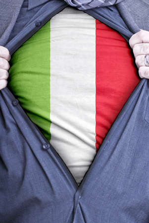 italian politics: An Italian businessman rips open his shirt and shows how patriotic he is by revealing his countries flag beneath printed on a t-shirt