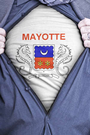 mayotte: A Mahorais businessman rips open his shirt and shows how patriotic he is by revealing his countries flag beneath printed on a t-shirt