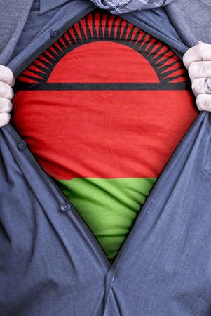 malawian: A Malawian businessman rips open his shirt and shows how patriotic he is by revealing his countries flag beneath printed on a t-shirt