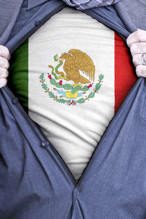 A Mexican businessman rips open his shirt and shows how patriotic he is by revealing his countries flag beneath printed on a t-shirt photo