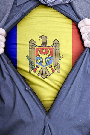 A Moldovan businessman rips open his shirt and shows how patriotic he is by revealing his countries flag beneath printed on a t-shirt