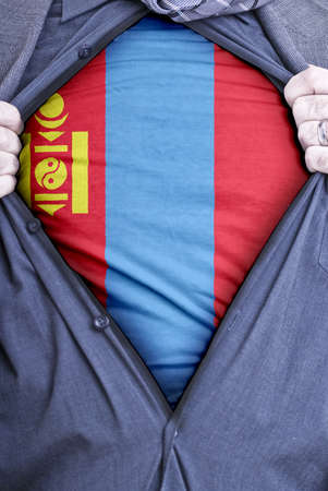 A Mongolian businessman rips open his shirt and shows how patriotic he is by revealing his countries flag beneath printed on a t-shirt photo