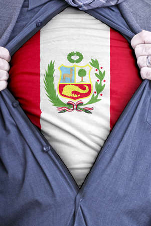 A Peruvian businessman rips open his shirt and shows how patriotic he is by revealing his countries flag beneath printed on a t-shirt photo