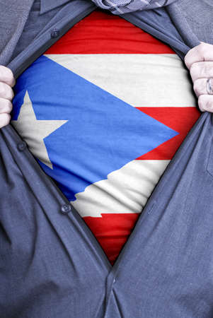 puerto rican flag: A Puerto Rican businessman rips open his shirt and shows how patriotic he is by revealing his countries flag beneath printed on a t-shirt