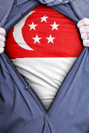 singaporean flag: A Singaporean businessman rips open his shirt and shows how patriotic he is by revealing his countries flag beneath printed on a t-shirt