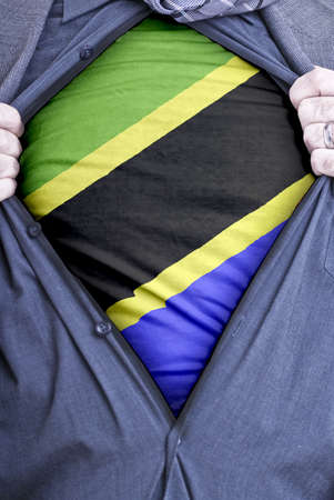 A Tanzanian businessman rips open his shirt and shows how pattic he is by revealing his countries flag beneath printed on a t-shirt Stock Photo - 12991099