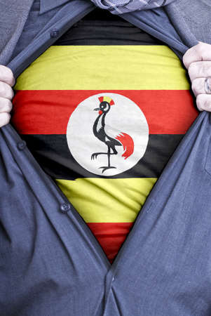ugandan: A Ugandan businessman rips open his shirt and shows how patriotic he is by revealing his countries flag beneath printed on a t-shirt