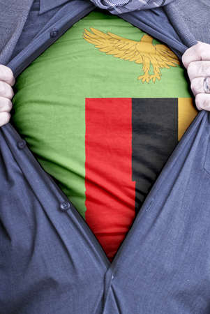 zambian: A Zambian businessman rips open his shirt and shows how patriotic he is by revealing his countries flag beneath printed on a t-shirt Stock Photo