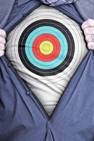 A businessman rips open his shirt and shows how perfect he is for your needs by showing off a target printed on a t-shirt Stock Photo - 13838316