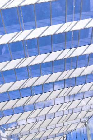 view of an atrium in a building: The glass atrium roof in a modern metropolitean building. Stock Photo