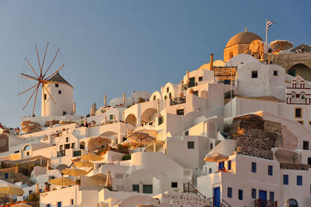 One of the traditional windmills of Oia at sunset on the greek paradise island of Santorini. Stock Photo - 13838307