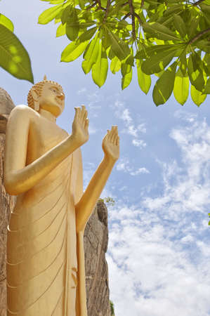 The Very large standing buddha situated in the Khao Takiab region of Hua Hin in Thailand. The area is also known as monkey or chopstick mountain. photo