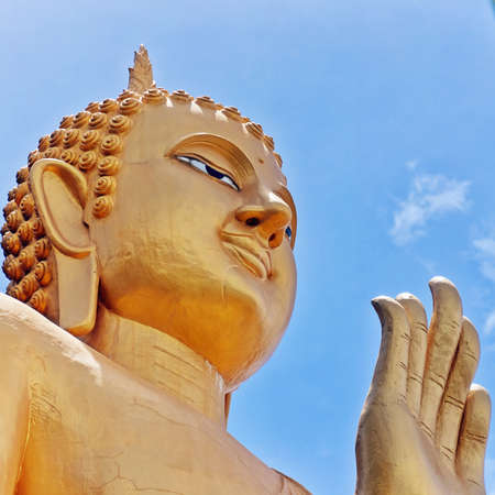 The Very large standing buddha situated in the Khao Takiab region of Hua Hin in Thailand.The area is also known as monkey or chopstick mountain. Stock Photo - 13838311
