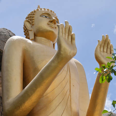 The Very large standing buddha situated in the Khao Takiab region of Hua Hin in Thailand.The area is also known as monkey or chopstick mountain. Stock Photo - 13838304