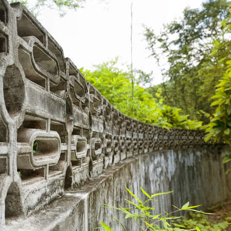 asien: A shallow depth of field view of an old asien temple boundary in Hua hin, Thailand.