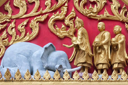A close up view of the kind of detail that adorns the buddhist temples in Thailand. Stock Photo - 13838332
