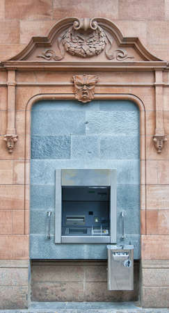 cashpoint: A cashpoint machine situated in an urban location.