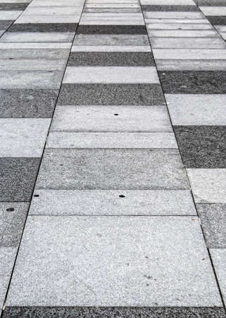 An abstract background image of a typical sidewalk or pavement. photo