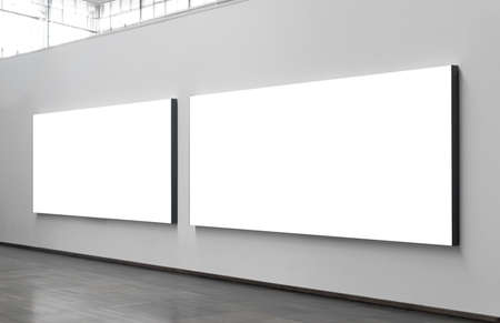 Two blank billboards situated at a generic city location that could be anywhere in the world  Imagens