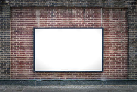 blank billboard: one blank billboard attached to a buildings exterior brick wall  Stock Photo