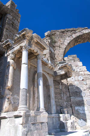 Ancient Roman ruins of a main city gateway situated in the Turkish town of Side  photo