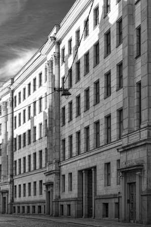 A monochromatic image of a street in the Latvian capital of Riga with typical soviet style architecture