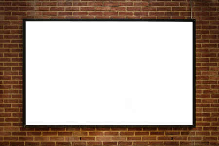 One blank billboard attached to a buildings exterior brick wall. photo