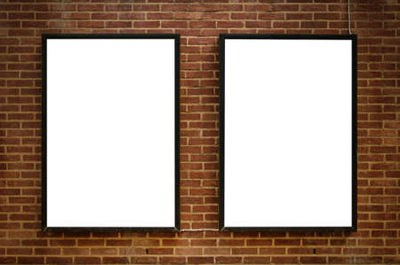 Two blank billboards attached to a buildings exterior brick wall. photo
