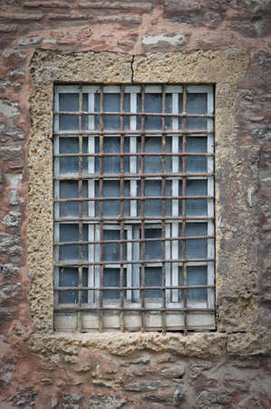 A barred window from the Hagia Irene Mosque in Istanbul, Turkey. photo